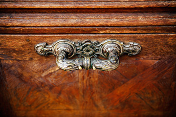 Door handle in vintage style on a old wooden door