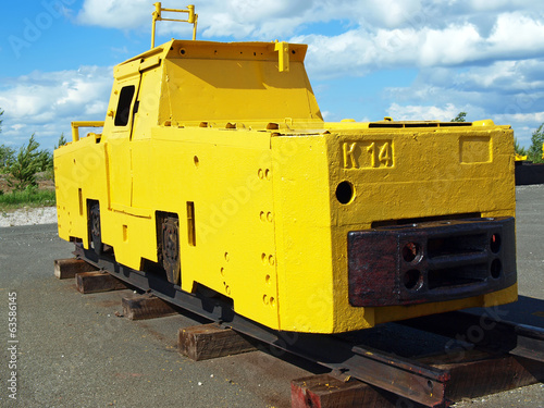 Mine locomotive on blue sky background
