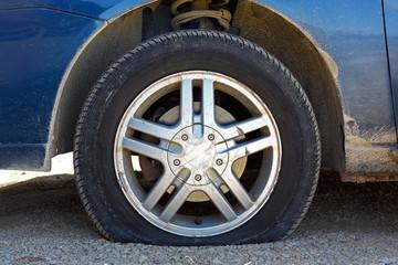 Flat Car Tire on Gravel Road