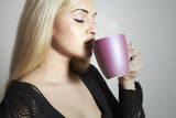 GiBeautiful woman drinking Coffee.Blond rl with tea.Delicious