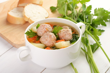 Meatball soup in white bowl