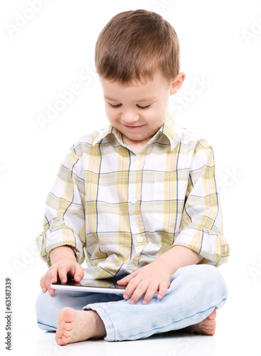 Young boy is using tablet