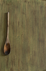 Wooden kitchenware on green background