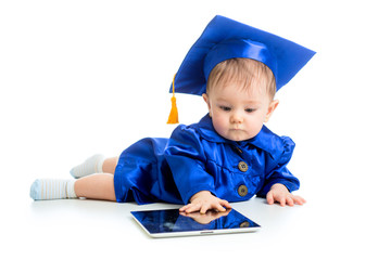 funny baby in academician clothes  using tablet PC