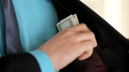 Buinessman with Dollars in Pocket