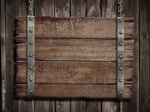 Medieval wood sign board over old wooden plaque