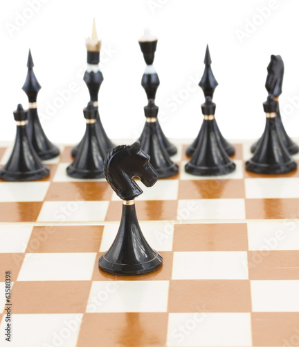 black knight in front of black chess