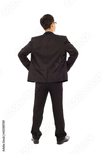 businessman standing and put hand on waist.
