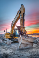 excavator on sunset landscape
