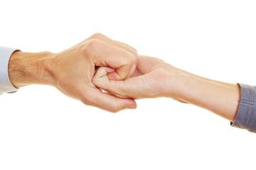 Zwei Hände fassen sich als Spirale