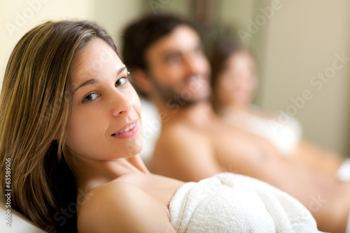 People relaxing in a spa