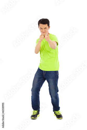 funny young man make a hand gun gesture
