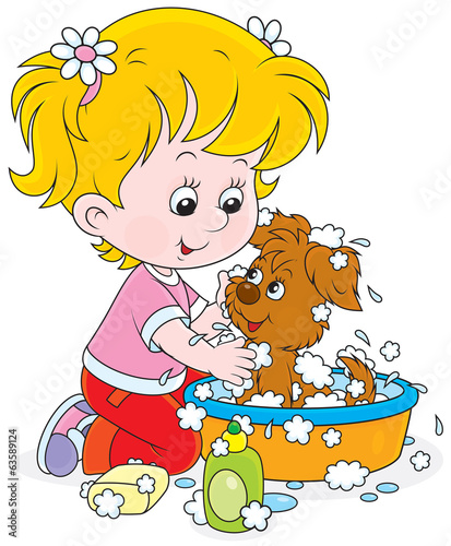 Little girl washes a small pup in a basin with lather