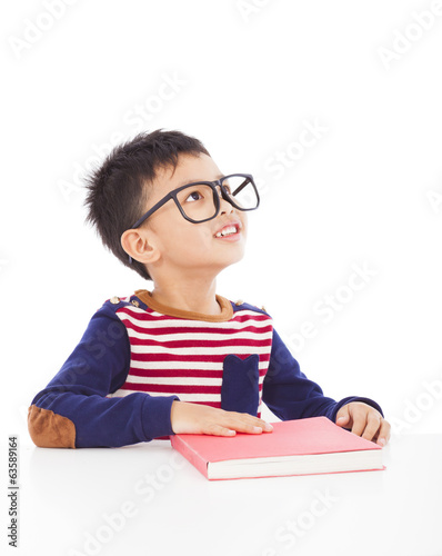 Portrait of young happy boy with book