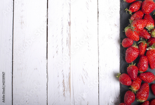 Strawberries on a white tabletop eve