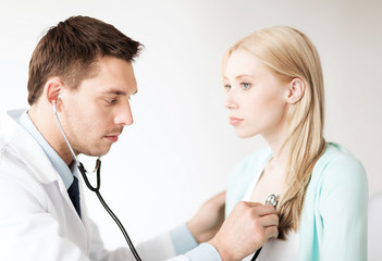 doctor with stethoscope listening to the patient