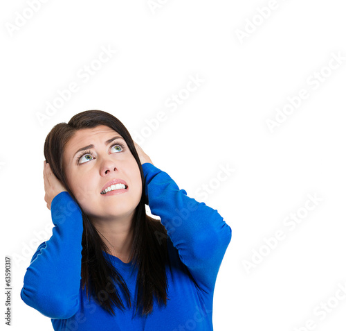 Woman covering ears, doesn't like loud noise