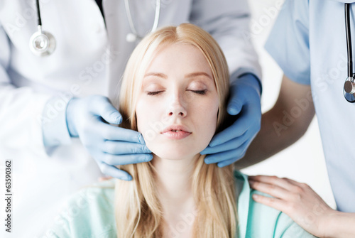 plastic surgeon or doctor with patient