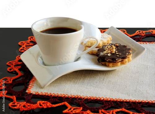 cup of black coffee and tasty cookies