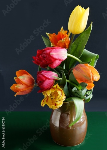posy of multicolor tulips in ceramic mug