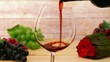 Pouring red wine and rose