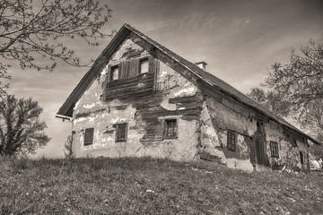 Old abandoned house entrance in bw