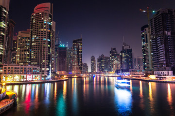 Modern city buildings at night, Dubai