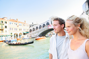 Venice couple by Rialto Bridge on Grand Canal