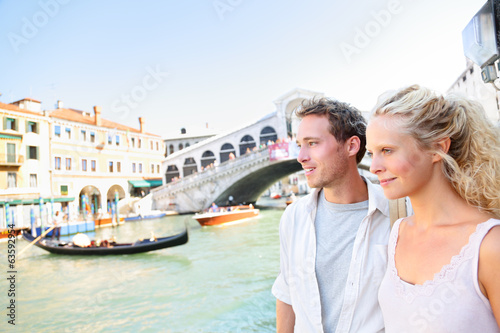 Venice couple by Rialto Bridge on Grand Canal