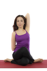 Young woman idoing Cow Face Pose in Yoga
