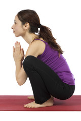 Woman doing Garland Pose in Yoga