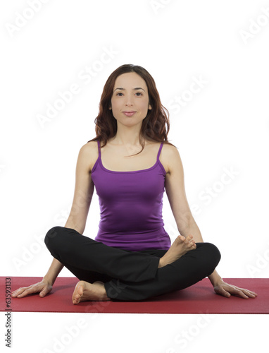 Young woman doing Fire Log Pose in yoga