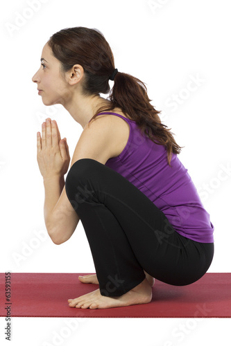Woman doing Garland Pose in Yoga