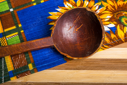 wooden spoon on kitchen towel background
