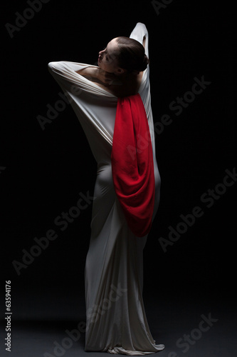 Artistic female dancer posing back to camera
