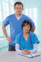 medical doctors asian female and caucasian male at the table loo