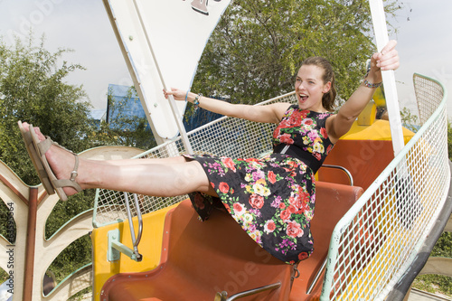 Girl flying on a park ride