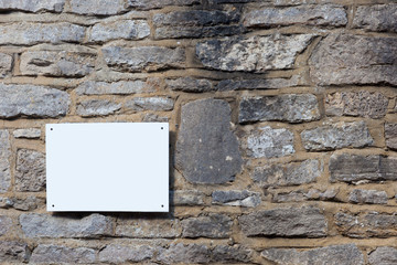 Blank sign on a slate wall