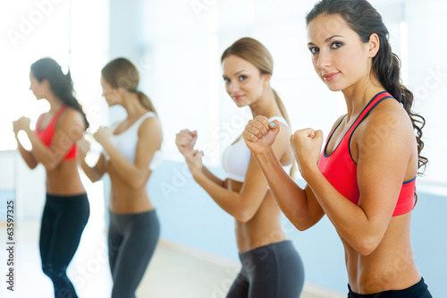 Women exercising. - 63597325