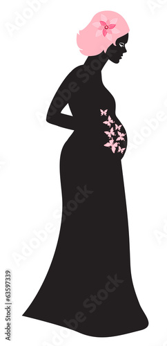 Pregnant woman looking at her belly in which butterflies