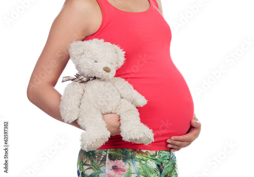Pregnant woman with a teddy