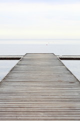 old wooden pier at the sea