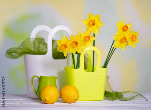 Spring bright still life with flowers and decor details