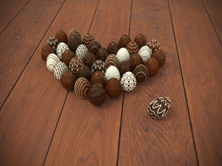 Chocolate Easter eggs heart on brown wooden floor