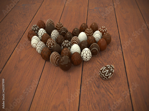 Chocolate Easter eggs heart on brown wooden floor