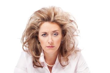 Stressed woman raising one eyebrow