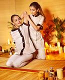 Fototapety Woman getting massage in bamboo spa..