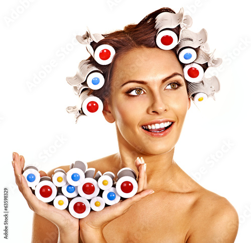 Woman wear hair curlers on head.