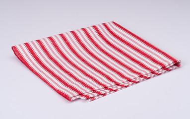 Red White Folded Napkin On White Background