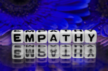 Empathy text with blue flowers